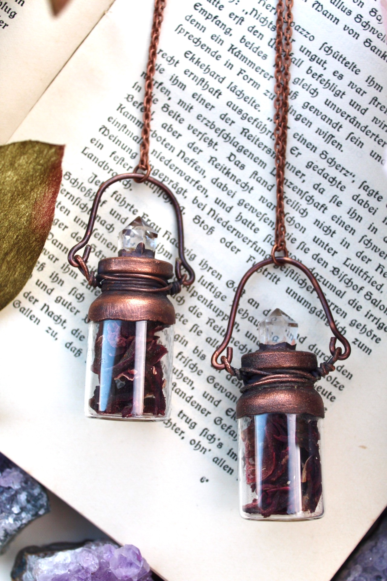 flower bottle necklace with hibiscus petals and clear quartz